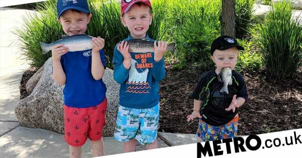 Mum takes hilarious picture when her son doesn't understand how to hold a fish