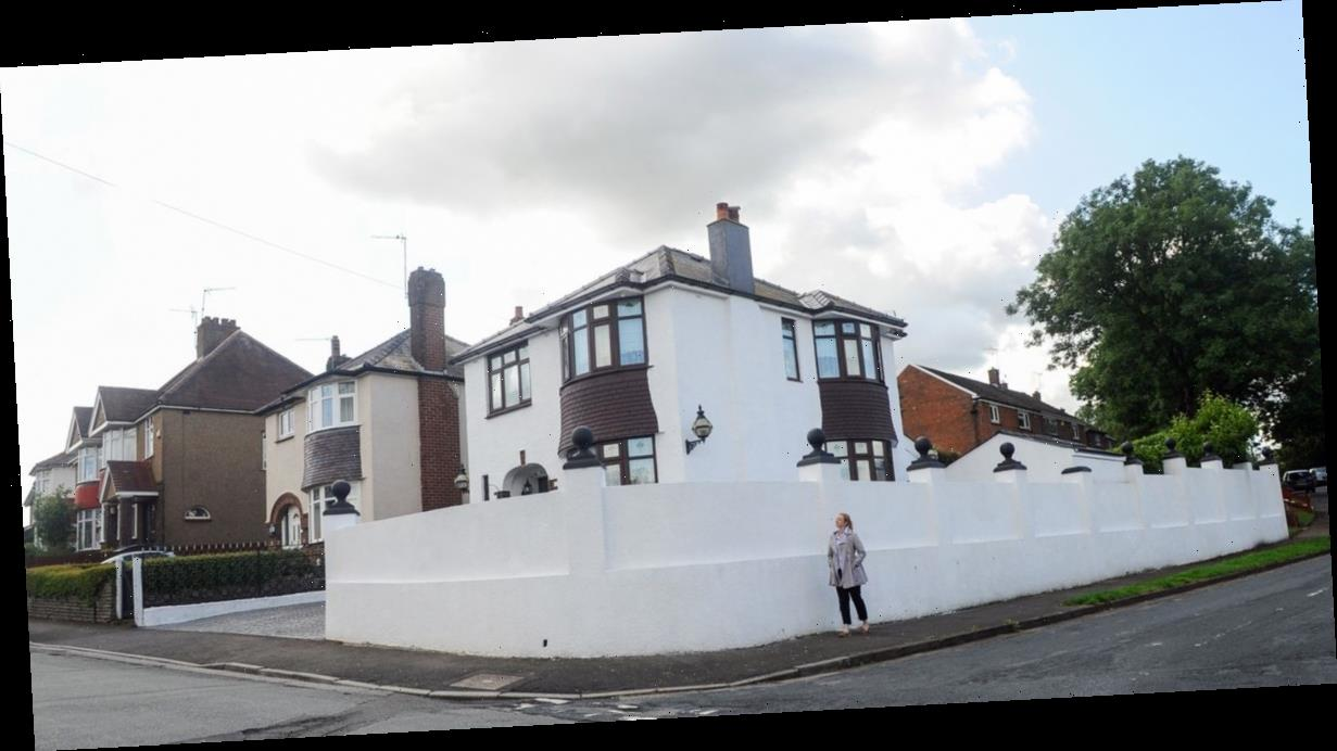 Mum wins battle to keep 10ft 'Riviera-style' white wall around detached home