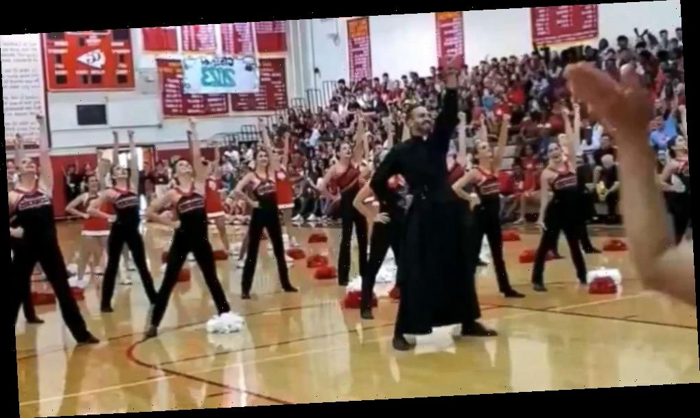 This dancing priest busts a move at a school pep rally in viral video