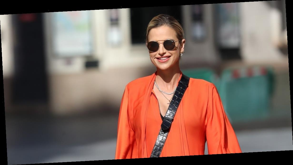 Vogue Williams shows off her blossoming baby bump in gorgeous flowing orange dress