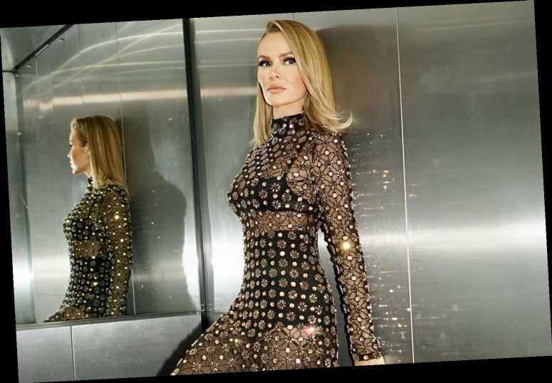 Amanda Holden wows fans in see-through dress and heels as she poses in a lift