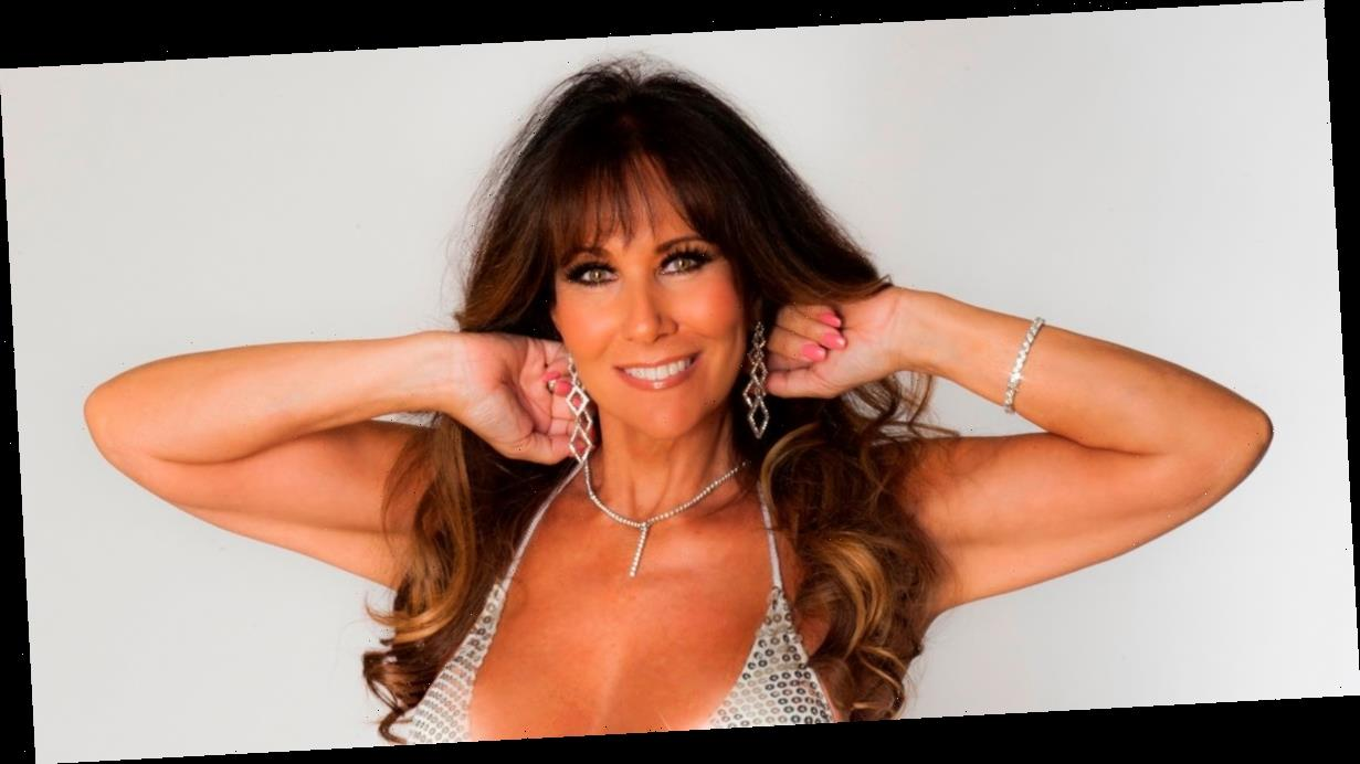 Page 3's Linda Lusardi, 61, strips to bra as she flaunts her hair transformation