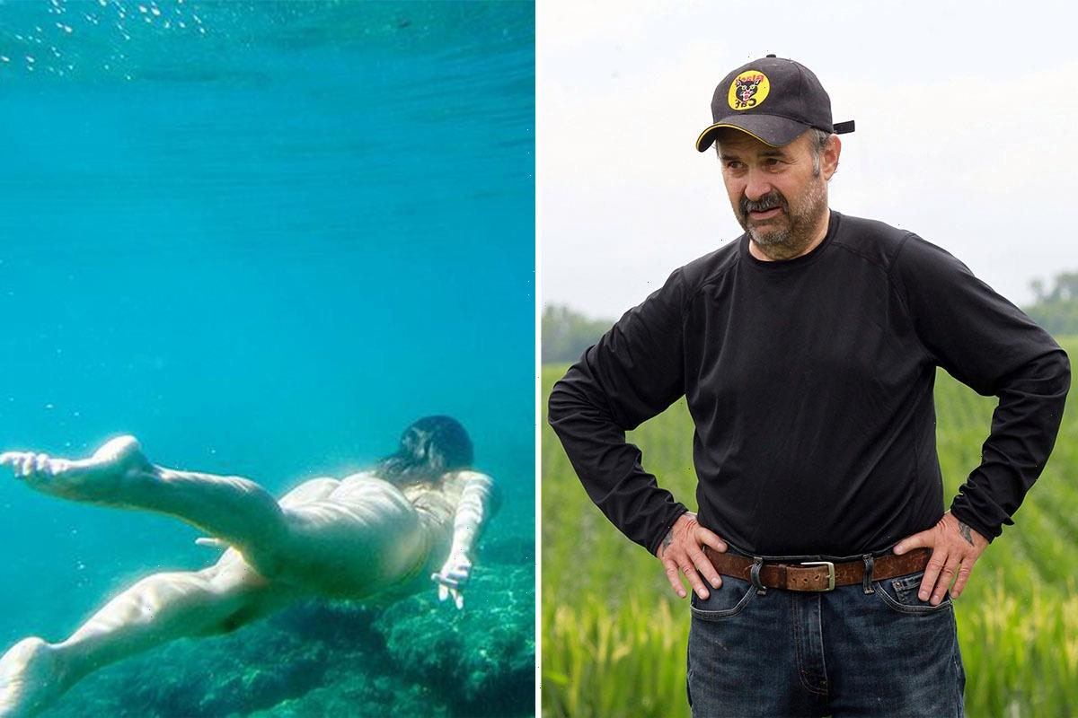 American Pickers' Danielle Colby swims in a bikini to celebrate ocean conservation after ripping Frank Fritz as 'unwell'